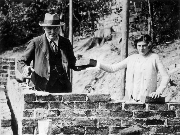 Winston Churchill and his daughter Sarah laying bricks at their house in Chartwell, Kent, September 1928